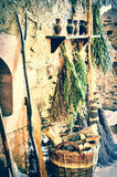 Rustic setting with old  furnace and wicker basket Royalty Free Stock Image