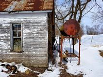 Rustic shed by fuel barrel. Abandoned shed next to a fuel barrel Royalty Free Stock Photos