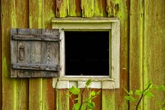 Rustic shutter to fit small window Stock Photo