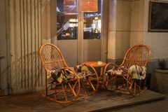 Rustic Sidewalk Cafe with Wooden Tables stock photography