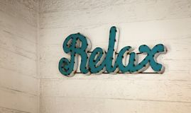 Rustic sigh `Relax` Stock Photo