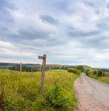 Rustic signpost pointing to Ditchling Beacon Royalty Free Stock Image