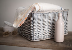 Rustic Silver Wicker Linen Basket on a shelf Stock Image