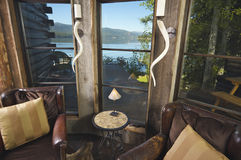 Rustic Sitting Room with Lakefront View Royalty Free Stock Photos