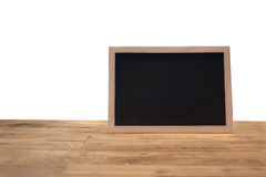 Rustic slate menu blackboard isolated on wooden desk with blank. Screen and can be add your texts or others on slate Stock Image