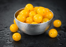 Rustic slate slab with Yellow Tomatoes, selective focus. Some Yellow Tomatoes on a slate slab as detailed close-up shot; selective focus Royalty Free Stock Images