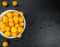 Rustic slate slab with Yellow Tomatoes, selective focus. Some Yellow Tomatoes on a slate slab as detailed close-up shot; selective focus stock photo