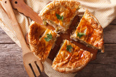 Rustic sliced chicken pie close-up on the table. horizontal top Royalty Free Stock Photography