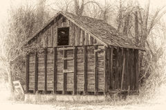 Rustic, small,  abandoned barn in woods Royalty Free Stock Photography