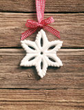 Rustic snowflake decoration on a ribbon Stock Photography
