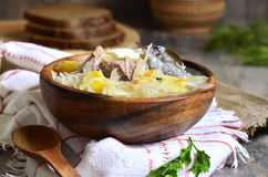 Rustic sour cabbage soup with goose in a wooden bowl. Royalty Free Stock Photo