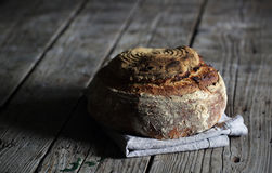 Rustic sourdough loaf, artesan bread on wood Royalty Free Stock Photo