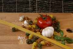 Rustic spaghetti and pasta. Pasta with a tomato, garlic, basil and some salt Royalty Free Stock Images