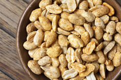 Rustic spicy dry roasted peanuts detail from above. Stock Images