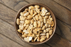 Rustic spicy dry roasted peanuts detail from above. Stock Photo