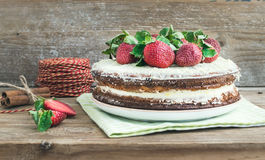 Rustic spicy ginger cake with cream-cheese filling and fresh str Royalty Free Stock Photos