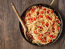 Rustic spicy italian crab and cherry tomato spaghetti pasta Royalty Free Stock Photo