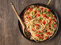 Rustic spicy italian crab and cherry tomato spaghetti pasta stock images