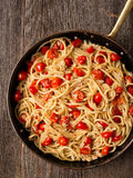 Rustic spicy italian crab and cherry tomato spaghetti pasta Royalty Free Stock Photography