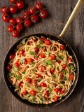 Rustic spicy italian crab and cherry tomato spaghetti pasta Royalty Free Stock Images