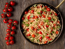 Rustic spicy italian crab and cherry tomato spaghetti pasta Royalty Free Stock Image
