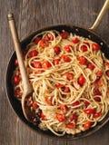 Rustic spicy italian crab and cherry tomato spaghetti pasta Stock Image