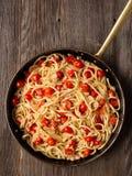 Rustic spicy italian crab and cherry tomato spaghetti pasta Royalty Free Stock Image