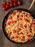 Rustic spicy italian crab and cherry tomato spaghetti pasta Royalty Free Stock Photo