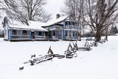 Rustic Split Rail Fence & Abandoned & Snow Covered Able Gabbard House - Kentucky. A rustic split rail fence frames the abandoned and snow covered Able Gabbard Stock Photos