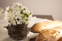 Rustic spring setting. Rustic setting with spring flowers and homemade bread royalty free stock photography