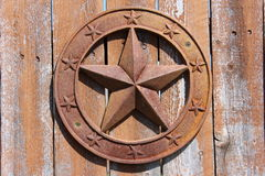 Rustic star. Rustic texas star with wood background Stock Images