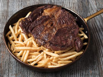 Rustic steak frites Stock Image