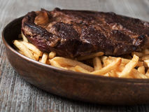 Rustic steak frites Stock Images