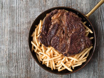 Rustic steak frites Royalty Free Stock Photo