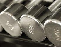 Rustic steel dumbells closeup vintage tone Stock Photo