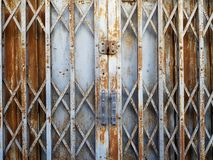 Rustic steel folding sliding door. Old rustic steel folding sliding door royalty free stock photos