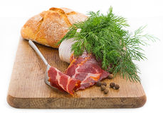 Rustic still life with bacon, bread, garlic and herbs Stock Photo