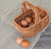 Rustic still life with basket with eggs Royalty Free Stock Photography
