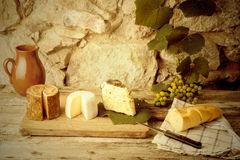 Rustic still life, cheese varieties Stock Photos