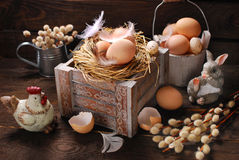 Rustic still life with eggs in nest on wooden box for easter Royalty Free Stock Photography