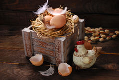 Rustic still life with eggs in nest on wooden box for easter Stock Photo