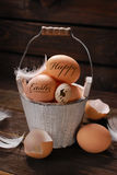 Rustic still life of eggs with written easter greetings in vinta Royalty Free Stock Photography
