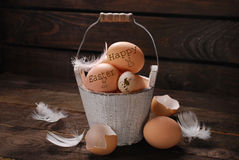 Rustic still life of eggs with written easter greetings in vinta Stock Image