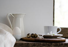 Rustic still life. fresh milk, cup of green tea, and eggs against a rustic background. Royalty Free Stock Photos