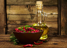 Rustic still life :  salad with beets , vegetable oil and rosemary Stock Image
