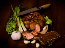 Rustic still life with sausage Stock Photos