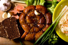Rustic still life with sausage Royalty Free Stock Images