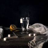 Rustic still life. Tea with lemon in a large circle on the wooden table. black background Stock Image