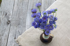 Rustic Still Life With A Bouquet Of Blue Flowers On A Wooden Bac