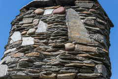 Rustic stone chimney Royalty Free Stock Photo